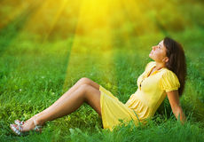 Young woman. Beautiful young woman relaxing in the grass Stock Images