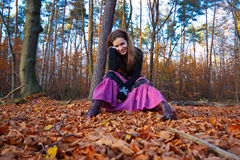 Young woman. In autumn park Stock Images