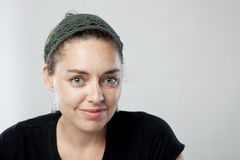 Young woman. Closeup portrait of a beautiful young woman wearing fashionable headwear Royalty Free Stock Photos