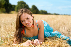 Young woman. Portrait of young woman lying in the field stock image