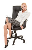 Young woman. Portrait of attractive business woman in chair Stock Photography