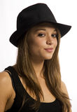 Young woman. Portrait of a young woman wearing a hat against a white background stock photo