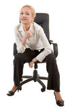 Young woman. Portrait of attractive business woman in chair Royalty Free Stock Photo