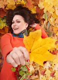 Young woman. In autumn orange leaves. Outdoor royalty free stock images