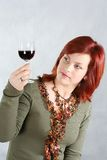 young woman. The beautiful woman with a glass of red wine Stock Photos