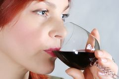 young woman. The beautiful woman drinks red wine Stock Photo