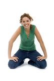 Young woman. Kneeling on the ground Royalty Free Stock Photos