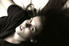 Young woman. Lying on the floor Royalty Free Stock Images