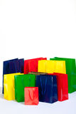 Young woman. Bunch of colourful shopping bags in diffrent sizes Royalty Free Stock Photos