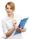 Young woman. Young pretty woman standing and holding blue tablet with pencil Stock Images