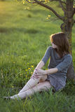 Young woman. A young woman sitting under the tree Stock Photos