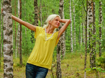 Young woman. Happy young woman among birch trees Stock Images