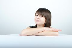Young woman. Leaning on a table stock images