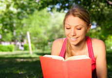 Young woman. Young beautiful woman with the book outdoors Stock Images