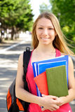 Young woman. Young beautiful woman with the books outdoors Royalty Free Stock Photo