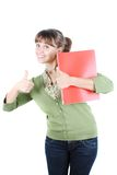 Young woman. Closeup portrait of a beautiful young woman showing thumbs up sign stock images