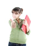 Young woman. Closeup portrait of a beautiful young woman showing thumbs up sign royalty free stock image