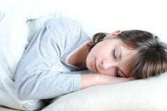 Young woman. Closeup portrait of a cute young woman sleeping on the bed stock photos