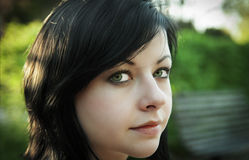 Young woman. Portrait of young beautiful girl in park Royalty Free Stock Photography