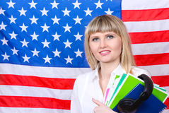 Young woman. On the background of the flag of America Stock Photo