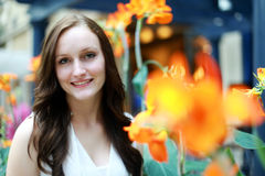 Young woman. A smiling young woman in tropical garden setting royalty free stock image