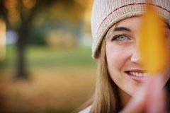 Young woman. Holding a leaf in front of her eye Royalty Free Stock Photo