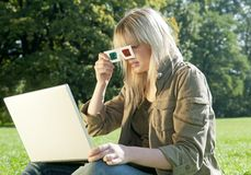 Young woman with 3D glasses and laptop. Young woman with 3D-glasses and laptop on a meadow Stock Photos
