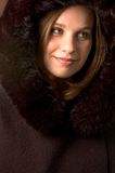 Young Woman. Pretty Young Woman Wearing A Fur Trimmed Woolen Coat Stock Photo