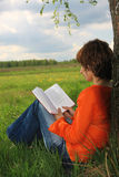 Young woman. Read book in garden royalty free stock images