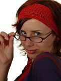 Young woman. Looking over eyeglasses, isolated on white background Stock Image