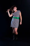 Young woman. A young woman on a plain black background wearing a striped dress Royalty Free Stock Photography