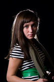 Young woman. A young woman on a plain black background wearing a striped dress Stock Image