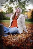 Young woman. Young college woman relaxing in the park with her laptop Royalty Free Stock Images