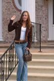 Young Woman 9. Young woman leaving a mansion, waving to friends Stock Image