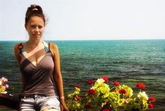 Young woman. At sea shore Stock Image