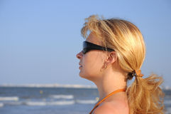 Young woman. Wearing a sunglasses on the tropical beach 2 Royalty Free Stock Photo