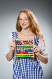 Young woman with abacus in school Stock Photos