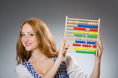 Young woman with abacus in school Royalty Free Stock Photo
