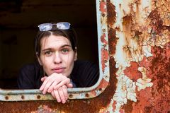 Young woman in an abandoned wagon train. Portrait of a young woman in an abandoned wagon train Stock Photo