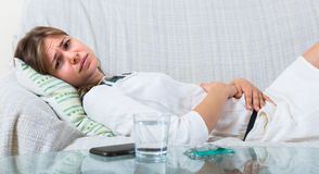 Young woman with abdominal pain Royalty Free Stock Images