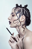 Young woman with abstract hairdo Stock Photography