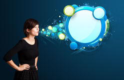 Young woman with abstract modern speech bubble Royalty Free Stock Image