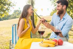 Young woman accepting with joy and emotion the marriage proposal. Beautiful young women accepting with joy and emotion the marriage proposal from her boyfriend royalty free stock photo