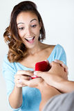 Young woman accepts an engagement ring Royalty Free Stock Photo