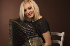 Young woman with with an accordion Royalty Free Stock Photos
