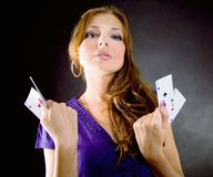 Young woman with aces four of a kind Royalty Free Stock Photography
