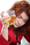 Young woman addicted to alcohol Stock Photo