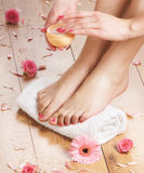 A young woman adding cream to her beautiful feet Royalty Free Stock Image