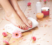A young woman adding cream to her beautiful legs Royalty Free Stock Image