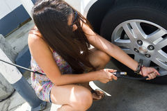Woman Inflating Tire Royalty Free Stock Photos